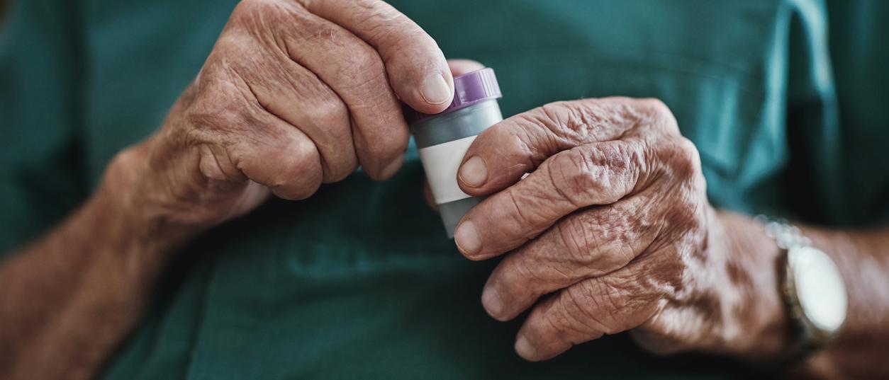 senior opens medications