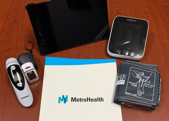 MetroHealth monitors COVID-19 patients in their homes with low-cost devices, including a Bluetooth-enabled tablet, pulse oximeter, thermometer, and spirometer.