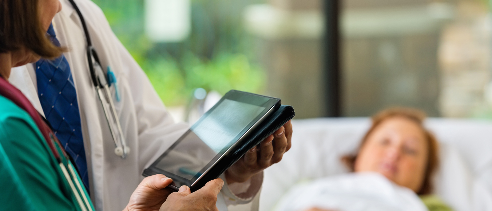 Doctors use electronic health records with patient