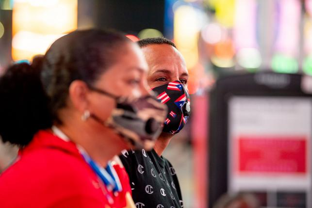Puerto Rican New Yorkers wearing masks in Times Square New York