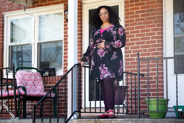 Ashley Esposito, who is pregnant with her first child due in July, stands outside her home in Baltimore, Maryland.