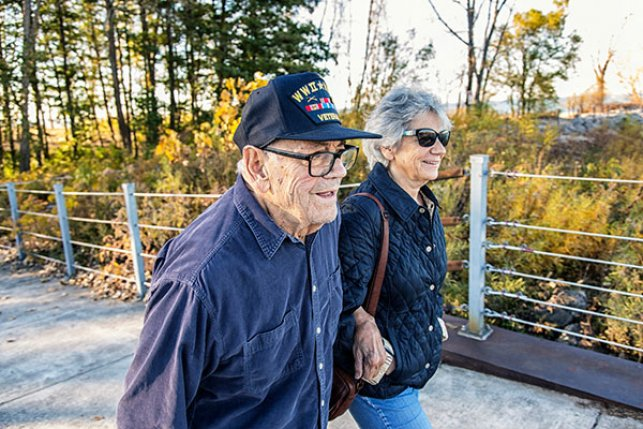 Medicare beneficiary and baby boomer daughter walking