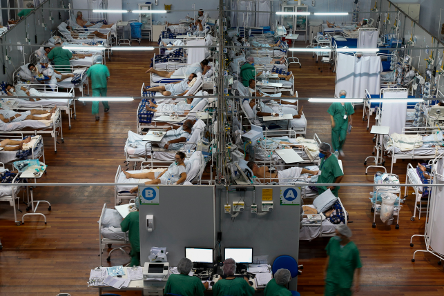 Patients affected by the COVID-19 coronavirus remain at a field hospital set up at a sports gym, in Santo Andre, Sao Paulo state, Brazil, on March 26, 2021.