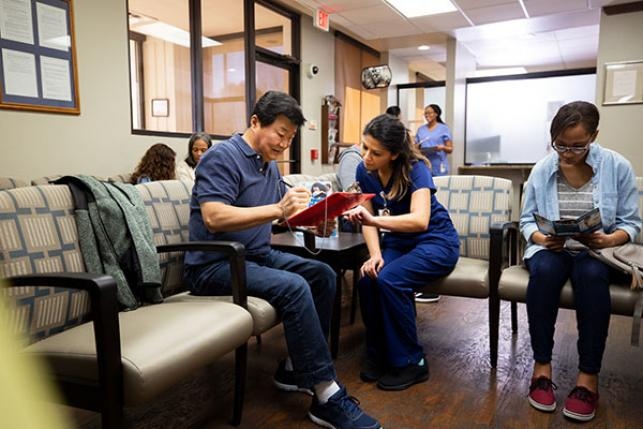 patient-gets-help-from-doctor-in-waiting-room
