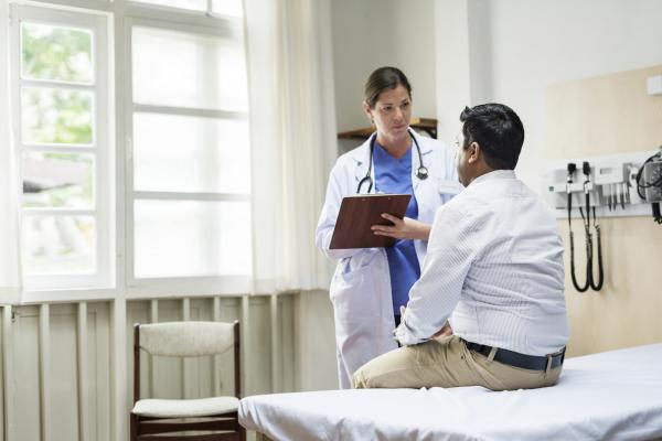 Doctor examines patient covered under Medicaid