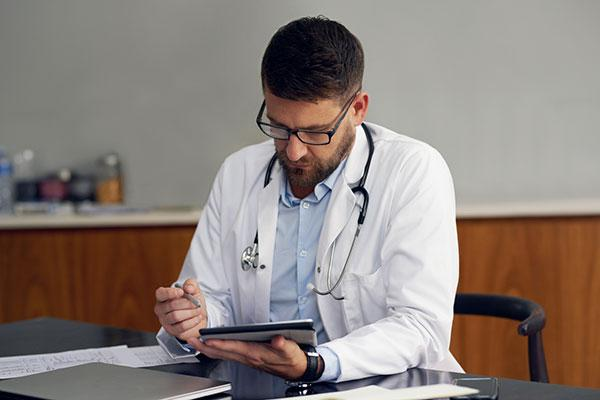 Doctor using telehealth to treat patient