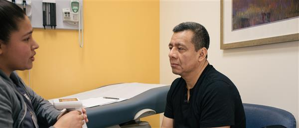 man consults with doctor