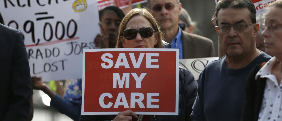 Woman with Save My Care protest sign