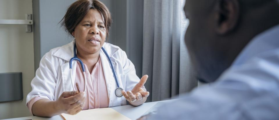 doctor talks to patients about costs