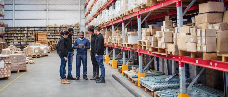 Small business meeting in warehouse