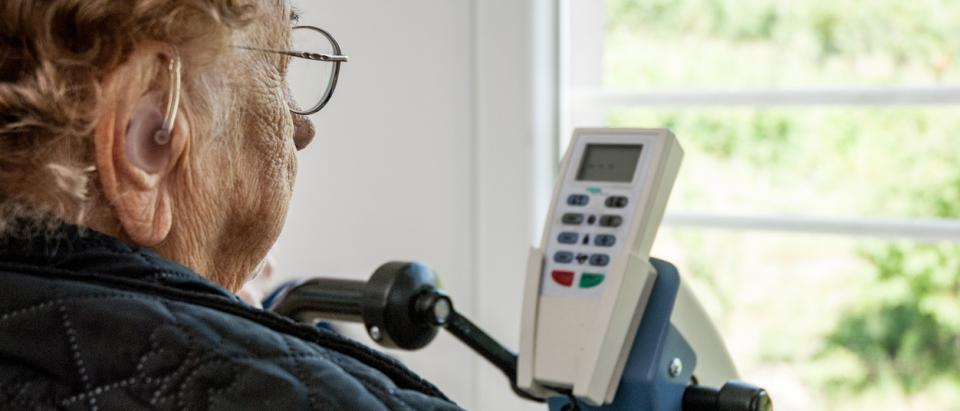 senior Medicare patient with hearing aid