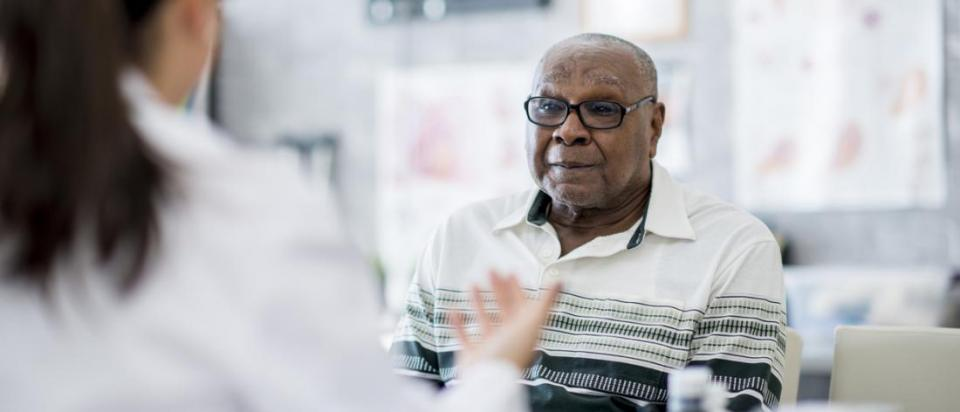 senior with Medicare discusses care with doctor