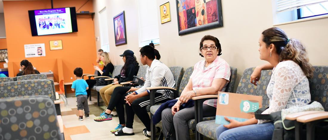 People in waiting room waiting for health care