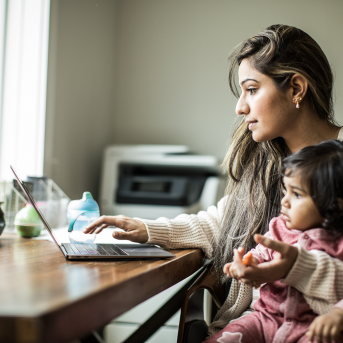Woman and daughter on computer