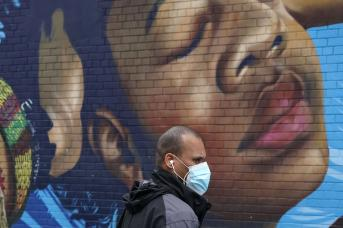 Black man wearing mask in the Bronx during the COVID-19 pandemic