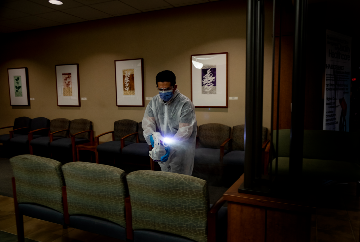 Octoclean worker Erick Borjas uses electrostatic disinfectant (ESD) to clean and rid a waiting room of COVID-19 during the coronavirus pandemic at a medical facility on April 15, 2020 in Riverside County, California.