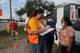 People line up to receive a rapid COVID-19 test among the agricultural community on February 17, 2021, in Immokalee, Florida.